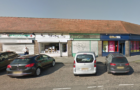 Police are appealing after a woman was robbed of her purse at Drylaw shop