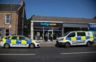 Police hunt man following tanning salon armed robbery